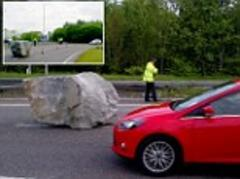 A real rocky road! Giant boulder causes hold-up on dual carriageway after falling off the back of a lorry