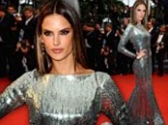 Alessandra Ambrosio slinks onto the Cannes red carpet in a movie star-worthy metallic gown