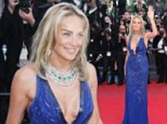 Sharon Stone, 55, steals the show in a plunging cobalt blue gown at Behind The Candelabra Cannes premiere