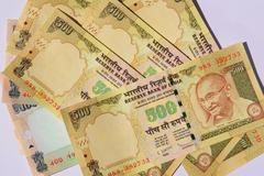 rupee up marginally by 6 paise at 55.35 against dollar
