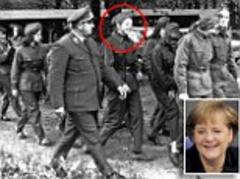 Angela Merkel under fire over Communist links as new image of her in uniform is released